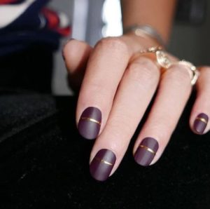 Burgundy Nails with a Gold Stripe