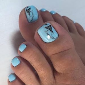 baby blue nails with a print