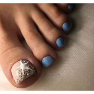 blue toenail design with nude accent