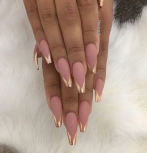 Golden tips on long coffin shaped nails