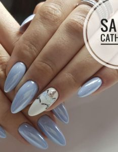 Blue nails with unicorn print