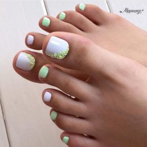 White and minty green toenails with floral embellishment