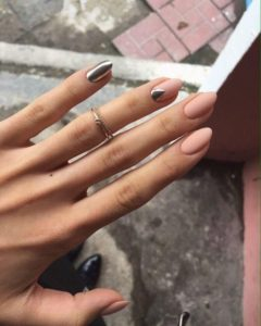 nude almond shaped nails with silver accent