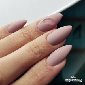 almond-shaped nails in nude