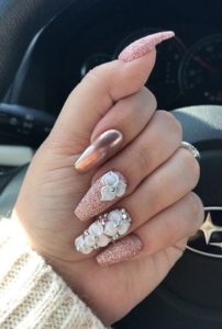 rose gold nails with shimmer and flower decor
