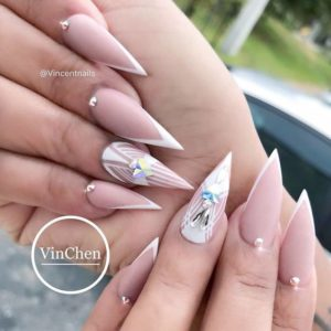 French stiletto nails with embellishment