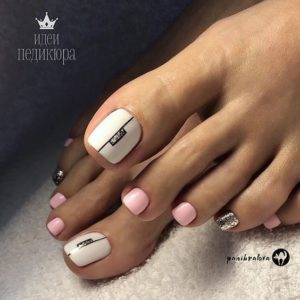 white and pink toenail design with shimmer