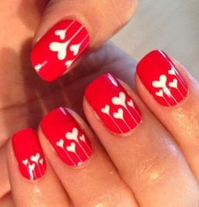 red nail white heart