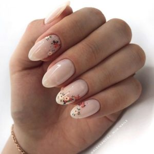 small floral art over pearl nude polish