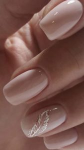 White feather on the ring finger nail