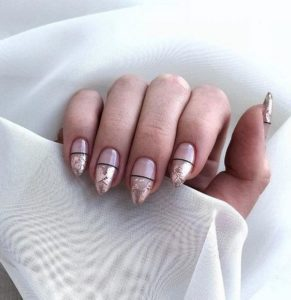 black line in the middle of nails and gold foil on nail tips