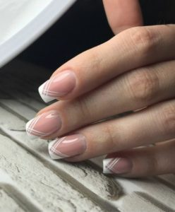 Thin lines crossing over at bottom of french manicure