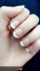 French manicure with a thin gold bottom lining