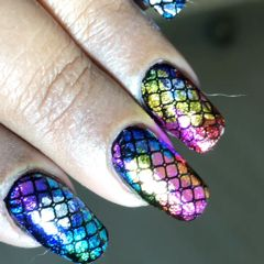different bright colour polish with net pattern over the nail design