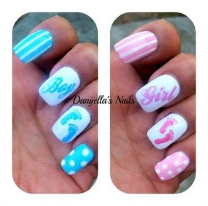 boy or girl written on accent nail with blue or pink polish