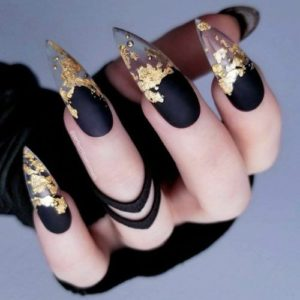 Black nails with clear tips and gold nail foil
