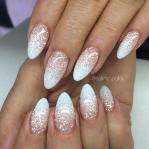 Clear sparkle polish over french manicure