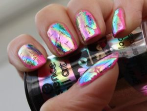Chrome nail foil on bright pink nails
