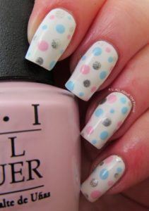 blue and pink spots on white base polish