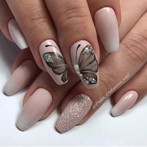 nude pink base and grey butterfly nail art over two nails