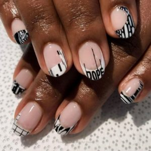 edgy designs on the white nail tips