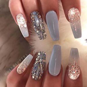 rhinestones and glitter polish to create a super sparkling look
