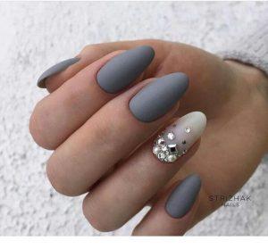 Lighter grey accent nail with rhinestones