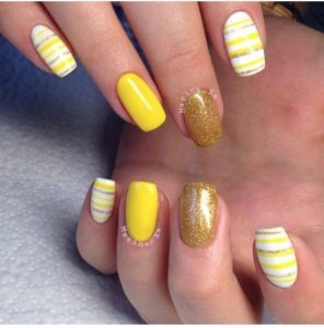 stripes nail art using different shades of yellow