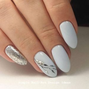 silver nail foil to create leaves on accent nail