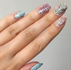 Leaf pattern on every nail in different colours
