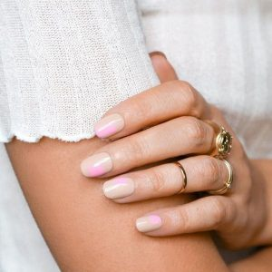 a hint of pink on nude nails