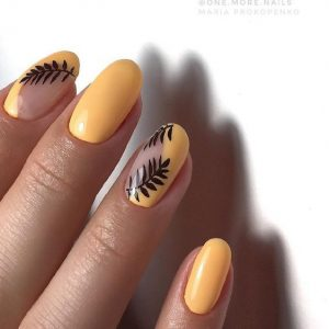 Half coated nails with fern leaves nail art