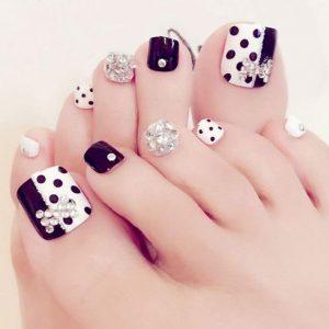 black white polka pedicure