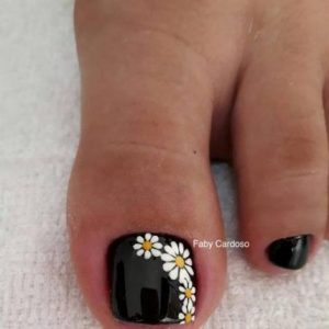white flowers on black toes