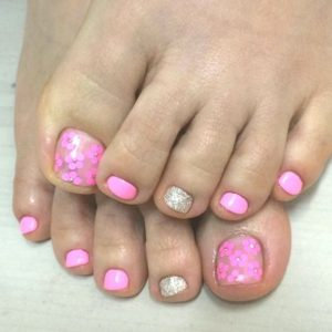 pink glitter flower over clear toes