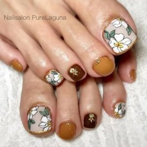 orange brown flower pedicure