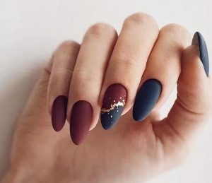red navy gold nails