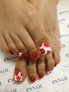 bright red floral pedicure
