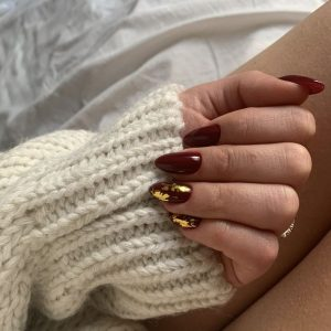 gold flaking on maroon