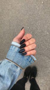 matte black and glitter almond nails