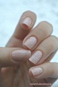 beige snowflake nails