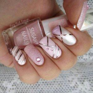 pink striped manicure