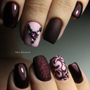 Burgundy and Pink Decorated Nails