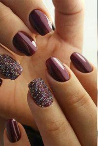 dark burgundy nails with glitter