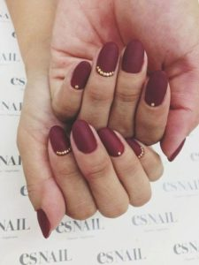 gold accents burgundy nails