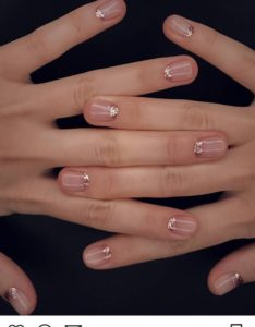 Nude nails and glitter