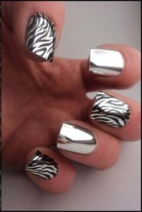 Zebra patterned and silver nails