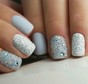 short blue nails with different patterns