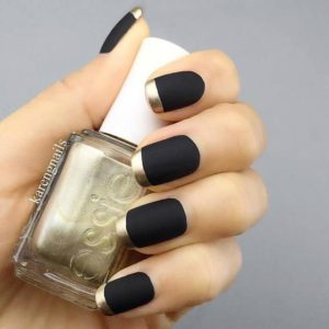 French manicure with black and gold