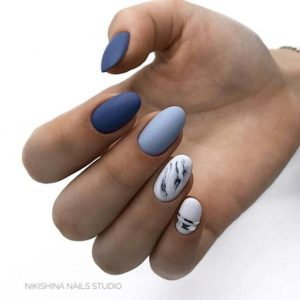 blue and white oval nail look